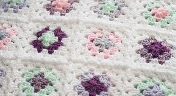 Pastel coloured crochet granny squares by Gemma Garner