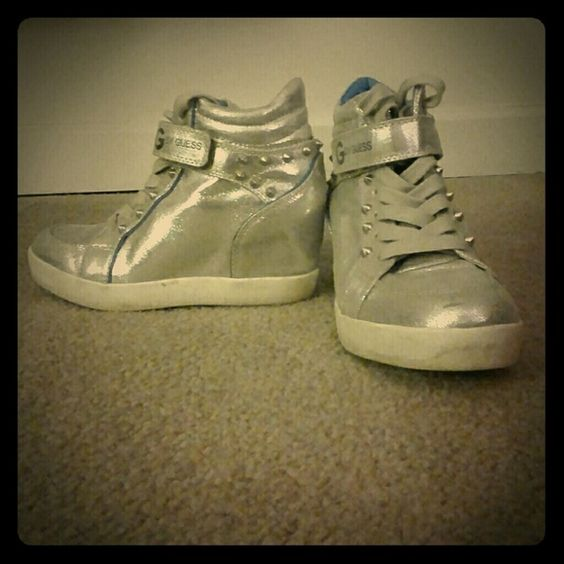 Guess Silver wedge sneakers Worn twice. Very comfortable wedge sneakers. Great for going out. G by Guess Shoes Wedges