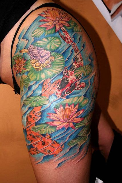 The flowers lotus shoulder tattoos and pond ideas on for Colorful thigh tattoos