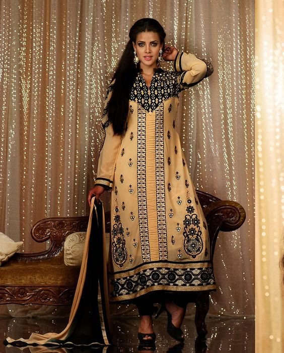 Beige and black long suit motifs on sleeves   1. Beige georgette long suit2. Comes with matching bottom and dupatta3. Can be stitched upto bust size 42 inches