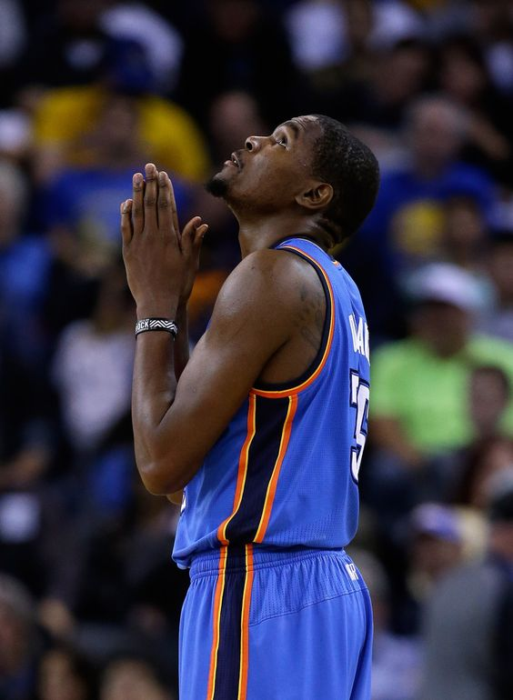 OAKLAND, CA - NOVEMBER 14: Kevin Durant #35 of the Oklahoma City Thunder prays after the Thunder were called for a foul during their game against the Golden State Warriors at ORACLE Arena on November 14, 2013 in Oakland, California.