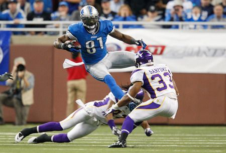 DETROIT, MI - DECEMBER 11: Calvin Johnson #81 of the Detroit Lions makes the catch a avoids the tackle of Mistral Raymond #41 and Jamarca Sanford #33 of the Minnesota Vikings during the game at Ford Field on December 11, 2011 in Detroit, Michigan. The Lions defeated the Vikings 34-28.  (Photo by Leon Halip/Getty Images)