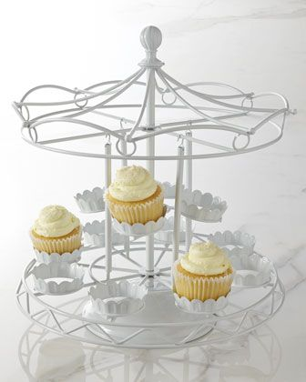 Darling carousel cupcake holder! Perfect for a circus or county fair birthday party or baby shower. LOVE! #circus #party #carouselcake