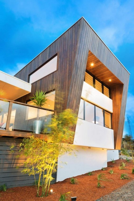 Home design, Fascinating Wooden Exterior With Concrete Wall And Windows Decoration At The Backside Of The House Along With Bright Lights And Simply Plants: Small Innovative and Energy –Efficient House in Australia