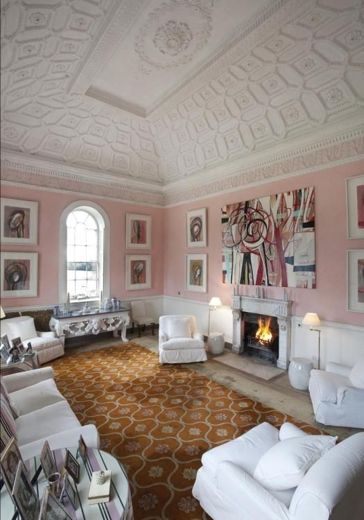 patterned trey ceiling, arched window, pale pink walls w/white-matted art