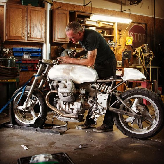 Cool guzzi cafe racer, but would ditch the wheels for spoked ones