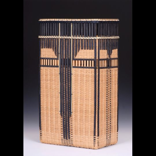 Leon Niehues is a studio basketmaker living and working in Huntsville, Arkansas. His baskets are made from the young white oak trees that grow in his immediate area of the Ozarks. While using traditional splint techniques, he has added innovative ideas, new construction methods, and simple design elements that dramatically change his oak baskets into exciting contemporary pieces.