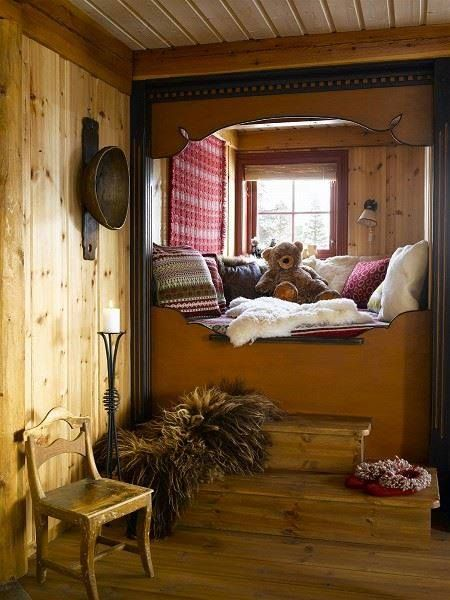 Rustic decor with built-in bed. The teddy bear is a nice touch.