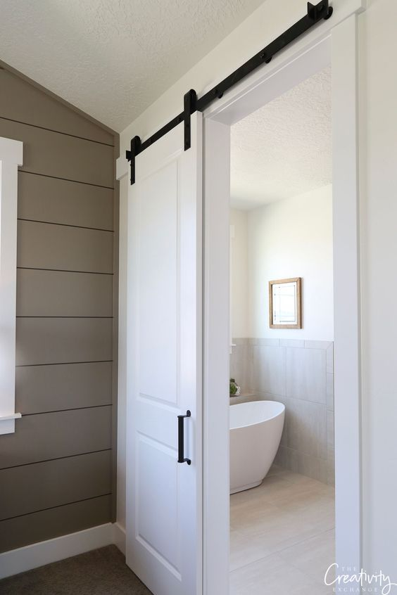 Maximize Every Inch Of Space In Your Bathroom Without Sacrificing Style And Functionality By Chec Bathroom Barn Door Interior Door Paint Colors White Barn Door