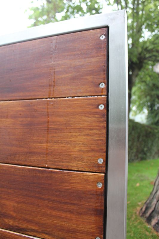 Modern Wooden Gates with stainless steel frame. Hard wood boards are stained with Sadolin Ultra Walnut stain and fixed with stainless steel screws for extra long durability.