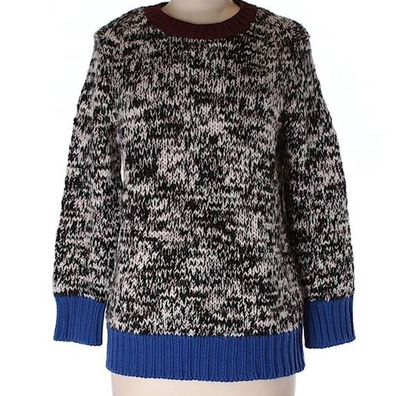 J. Crew color block sweater. This sweater is gorgeous!  Beautiful, warm quality J. Crew craftsmanship. Interweaved black and white threads with cobalt blue along the sleeves and hem line. Burgundy around the neckline. It looks beautiful with skirts, as well as leggings and skinnies. Clutch not for sale, used for styling purposes only.  trades, PayPal or holds. Mostly wool with some acrylic and other fibers. Worn once, like new. J. Crew Sweaters Crew & Scoop Necks