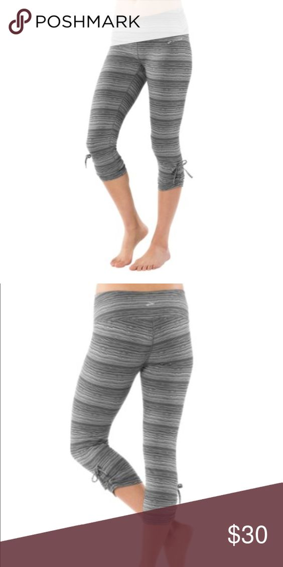 Brooks Urban Running Capris Black Jacquard NWOT - Whether you fall for their cute, cinched-cuff accents to their wide, Powermesh-lined waistband, Brooks' Urban Running capris will easily gain your affections; the stretchy, supportive knit fabric seals the deal. From a pet & smoke free home.  - Supportive stretch-knit fabric - Wide, flat waistband with Powermesh - Cinching ties at cuffs - Drop-in media pocket in waistband - Fabric: 86% polyester, 14% spandex or, 88% polyester, 12% spandex…