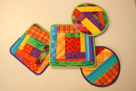 Finished coasters -Great use for scraps. The tutorial is great for using the stitch in the ditch foot with the center flange.  And the big bonus? No binding!