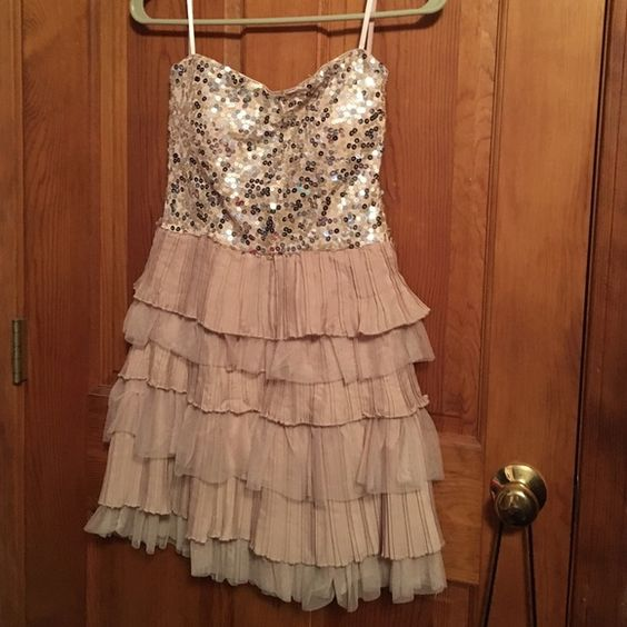 Cute light pink dress great for spring Cute dress the top half is all sequins while the bottom has a Ruffled material this dress does not have a zipper but looks adorable only worn once Love reign Dresses Strapless