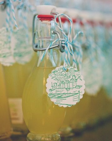 Bottles of Limoncello adorned with  hand-punched tags and strung with baker's twine