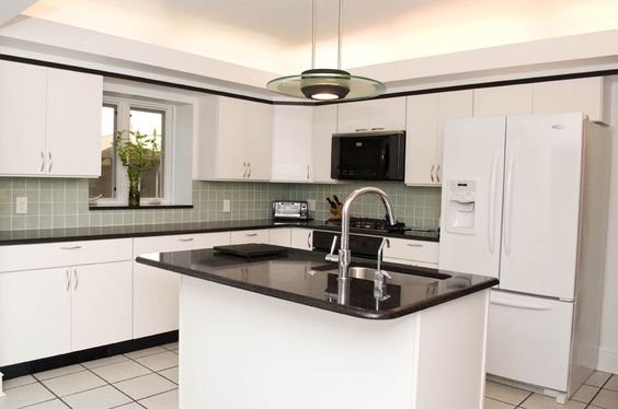 Contemporary kitchen with white cabinets and quartz for Ce kitchen cabinets
