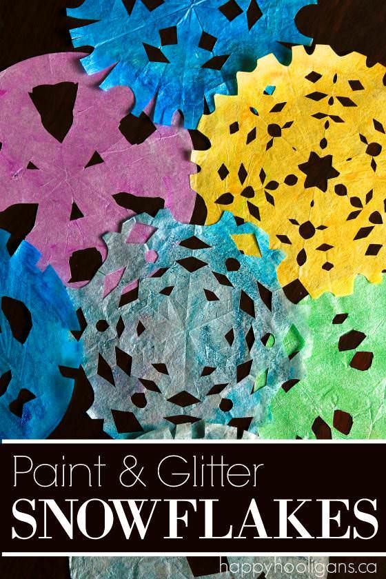 Painted Coffee Filter Snowflakes - A beautiful winter craft for kids of all ages.  Paint them, glitter them and hang them in a window at home or in your classroom - Happy Hooligans