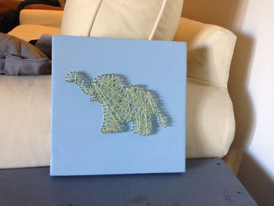 Great baby gift! Can be customized with color of string and wood color. 10 x 10 inches.    Picture shown is light green string with a matte baby blue