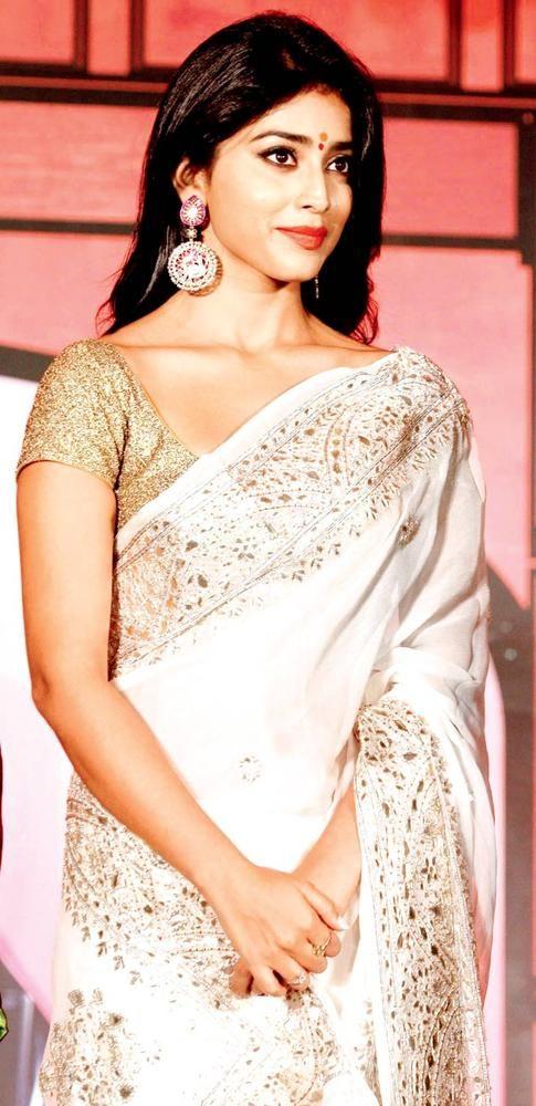 Shriya Saran Looks Elegant In A White And Golden Sari