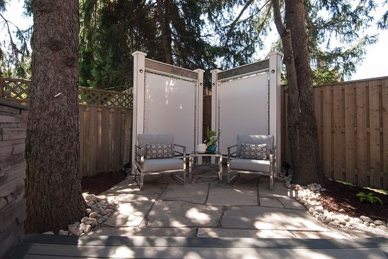 custom canvas screens with slate accented aerial beams create a sense of privacy for this. Black Bedroom Furniture Sets. Home Design Ideas