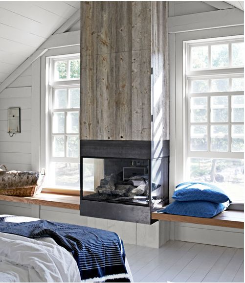 Sneaky Storage:    Faced with reclaimed white pine, the gas fireplace's chimney hides a surprise: a flat-screen TV.