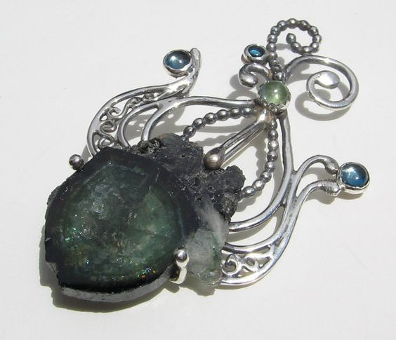 Gorgeous metalwork and a fantastic piece of tourmaline: Nereids- Sterling Silver, Tourmaline, and London Blue Topaz Pin and Pendant
