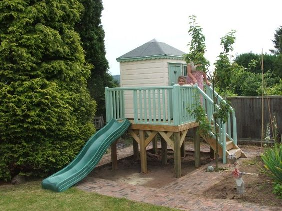 Wooden playhouse playhouse outdoor and garden playhouse for Wooden wendy house ideas
