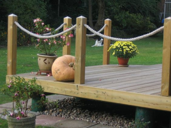 Decking ropes and railings on pinterest for Garden decking with rope