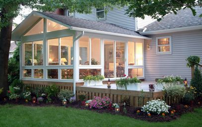 I love sunrooms! ♥ Like how this one leads to the hot tub.
