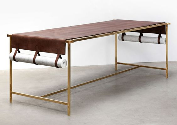 Leather table: Discarded Fendi leather, brass structure, marble weights  Photo© Luisa Zanzani