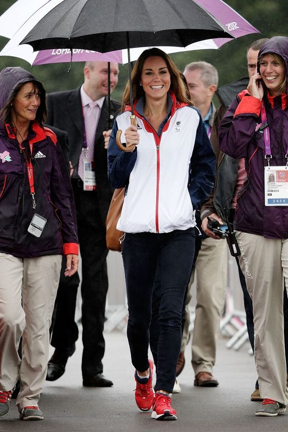 September 2, 2012: Kate cheers on Team GB at the Paralympic rowing event while wearing a Team GB jacket, navy skinny jeans and and red Adidas Supernova Glide 4 sneakers. (And while she may be royal, we're impressed that she carries her own umbrella.)