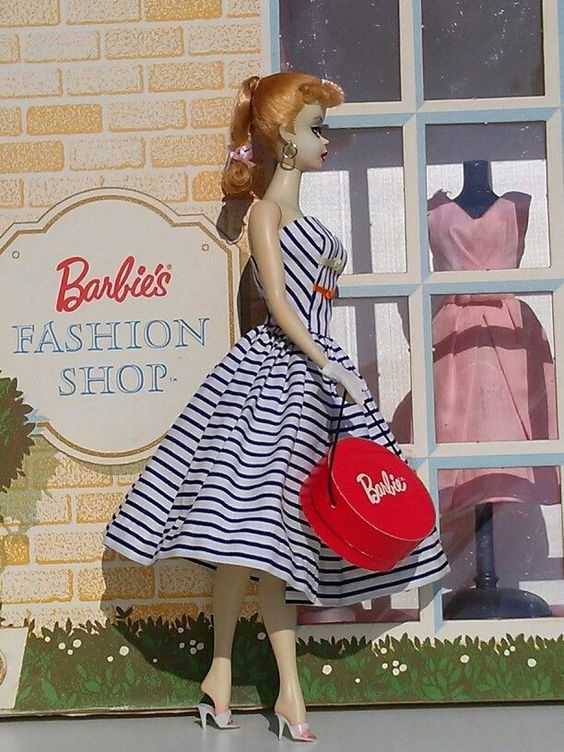 Original vintage #1 1959 Barbie goes shopping in original vintage Barbie sundress with cardboard hat box.