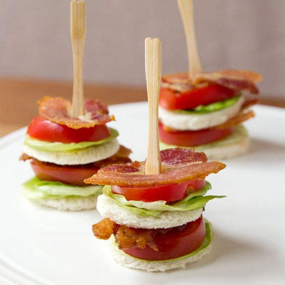 BLT Appetizer Ingredients 1 cup mayonnaise 1 cup sour cream Iceberg lettuce, shredded 2 large vine-ripe tomatoes, chopped 1 pound lean bacon, cooked crisp and crumbled Sea salt bagel chips  Combine the mayonnaise and sour cream in a small bowl with a snap-on lid. When well mixed, refrigerate until serving time. When ready to serve, place the mayonnaise mixture in a large serving bowl. Top with the lettuce, tomatoes and bacon. Serve with bagel chips.