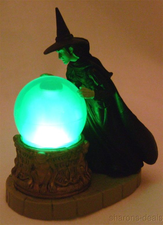 "This Commemorative Kit Contains: A figurine of the Wicked Witch of the West with a light-up crystal ball that glows smokey green. 32 page book of full-color photos and quotes from the movie. Replica is  2 3/4"" tall x 2 1/4"" wide, Book measures 2 1/2"" wide x 3"" tall. #stockingstuffer #christmasgift:"