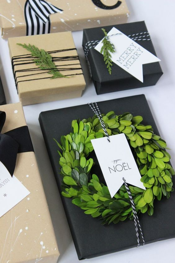 Kraft Paper with Black, White & Green. Holiday gift wrapping inspiration using kraft paper, black and white ribbon, baker's twine and greenery.