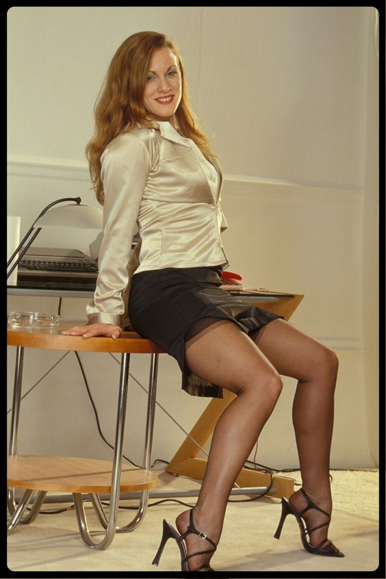 sexy redhead secretary in sheer black stockings legs stockings and