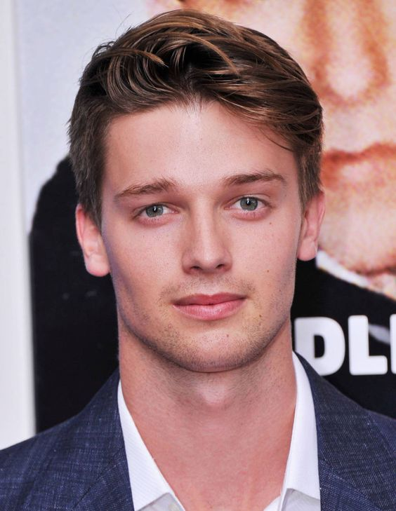 Town & Country's Top 50 Bachelors | Patrick Schwarzenegger, 20 - Part-time model and clothing designer (a charitable initiative called Project 360). Full-time USC student and brother at Lambda Chi. Son of Maria Shriver and Arnold Schwarzenegger. His confirmation name is Achilles.   LIKES: Frat parties; the Lakers.   NATURAL HABITAT: Courtside; shirtless on a billboard on Sunset Boulevard; Twitter, where he goes by the name Patrick Shriver.