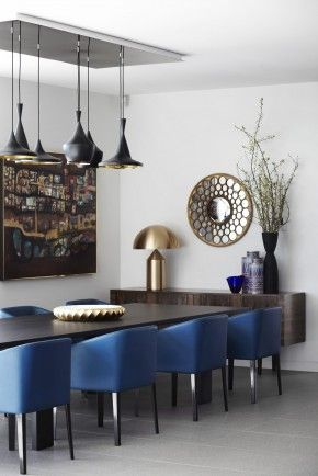 Modern dining room with blue barrel chairs & brass mushroom lamp