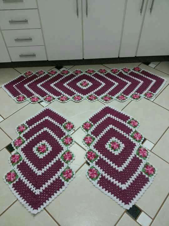 Neat! A mitred looking set of crochet rugs. I saw similar last night in very plain browns or grays. Looked perfect for a guy's room when done in those colors.