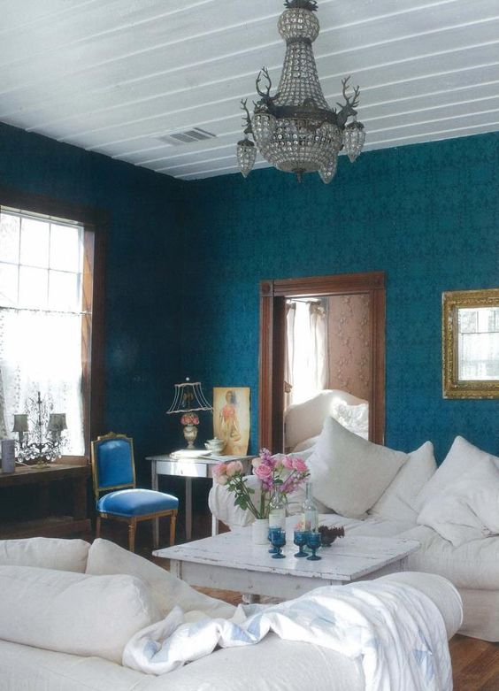 Rachel Ashwell living room...love the color saturated walls with all the white....