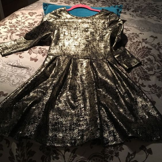 Metallic gold fit and flare dress Perfect for the holidays! Gold and black dress runs a bit big, got it in the juniors dep. it has stretch to it. I love this dress but I wish it was a bit more true to size. Worn literally once! Dresses Midi