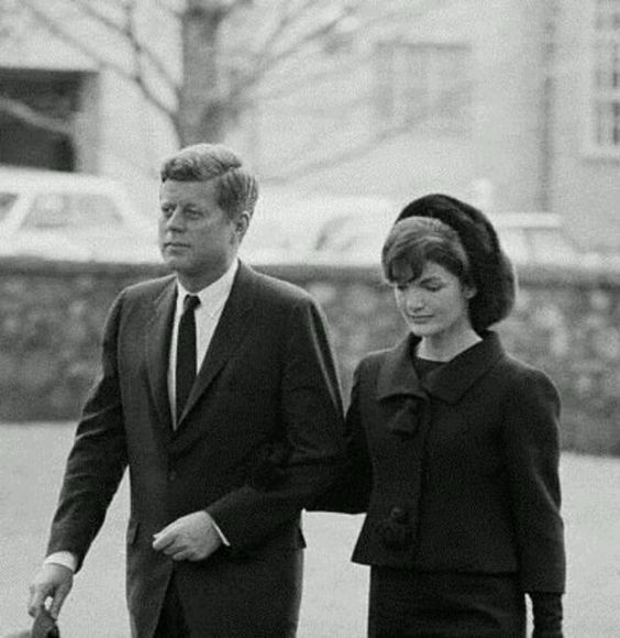 Jackie and John F. Kennedy walking to Eleanor Roosevelt's funeral, 1962.