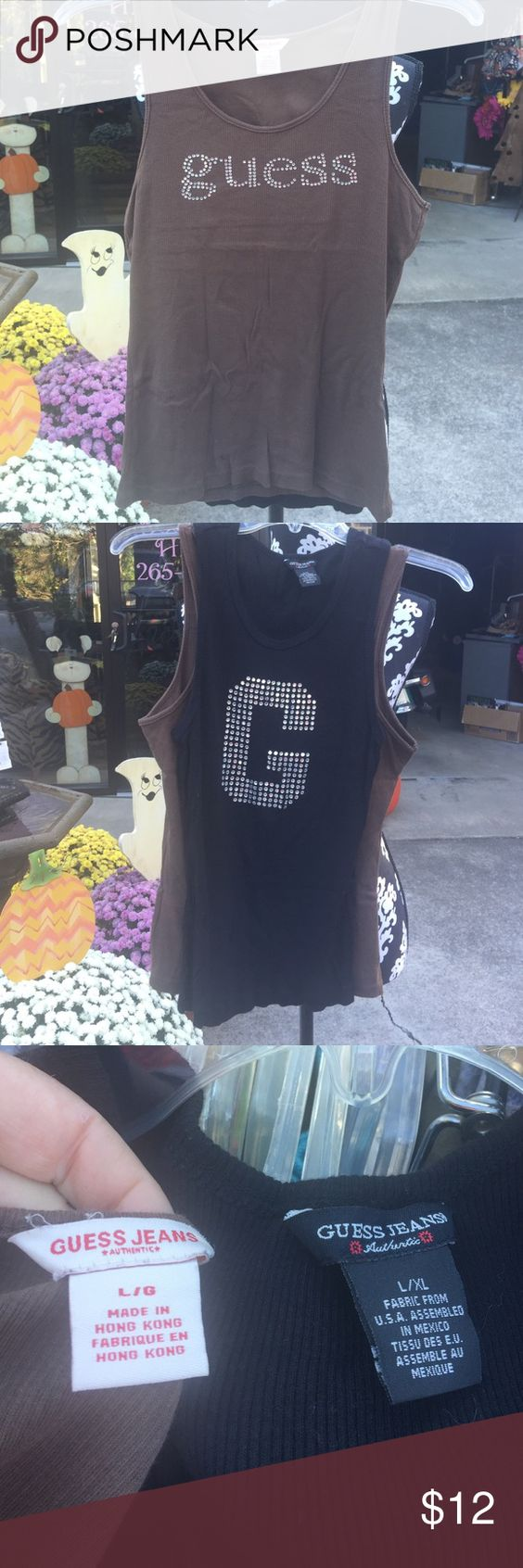 Set of 2 GUESS tanks One brown/one black GUESS tanks both with rhinestones! Guess Tops Tank Tops