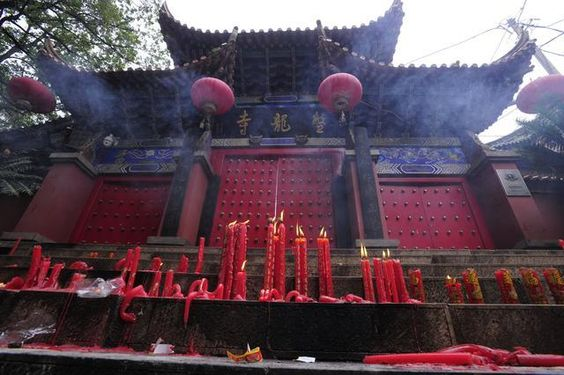 """Candles placed outside Panlong Temple by visitors who were not allowed inside, from """"Fearing 'commercialization', monks briefly close Jinning temple"""""""
