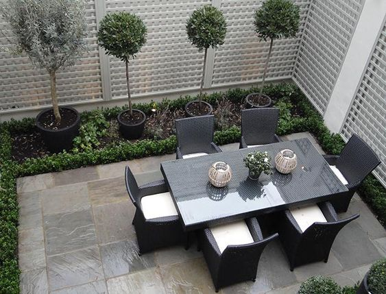 Kandla Grey Sandstone Paving is more often used in traditional designs, but this photo shows how effectively it can also be incorporated into a contemporary, urban garden.