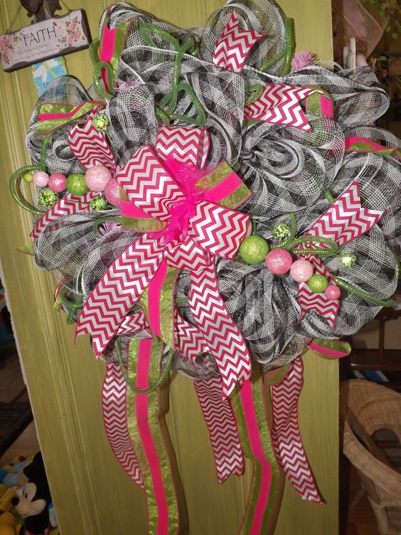 The image is sideways, Hot pink, lime green, black and white mesh wreath!  Chevron bow and ribbon loops.  View more of my work at https://www.facebook.com/forgetmenotskershaw