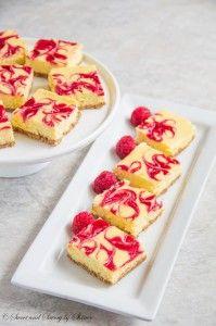 These soufflé-like lemon raspberry cheesecake bars are amazingly creamy and soft with burst of honey-glazed raspberry sauce.