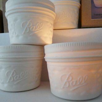 Porcelain votive candle holder.