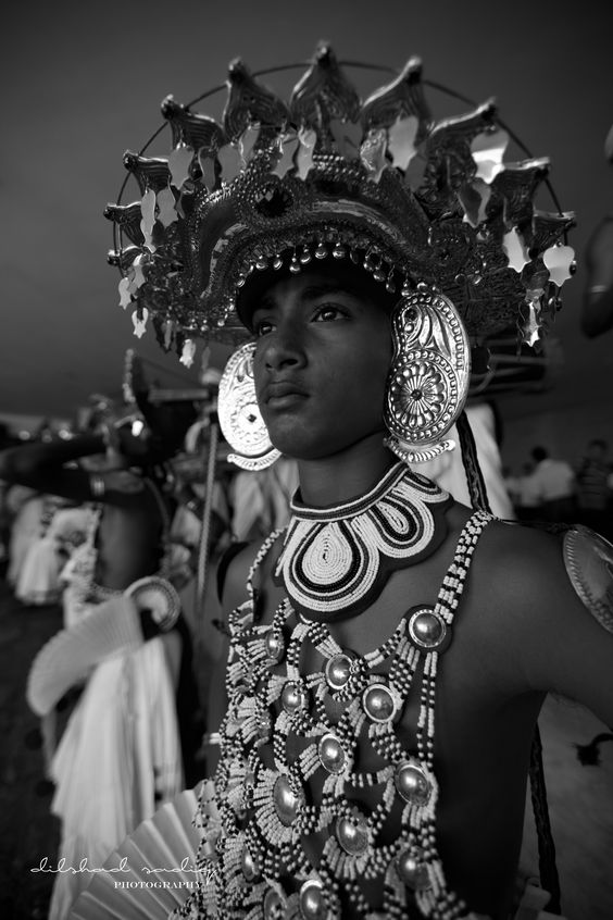 a more of a serious expression of a Kandyan dancer