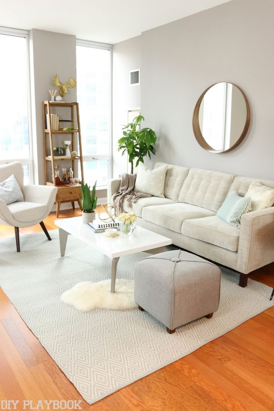 A neutral living room perfect for any city girl! Love the gold accents and quality furniture.: